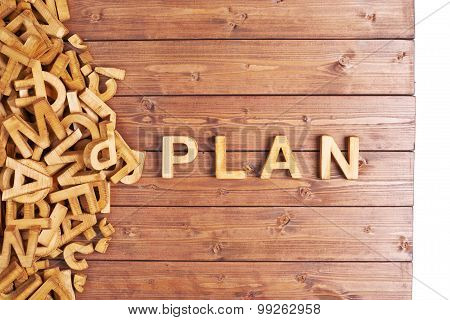 Word plan made with wooden letters