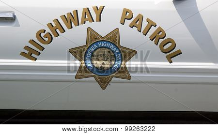 Highway Patrol Sign On A Police Car