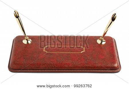 Red leather pen holder isolated