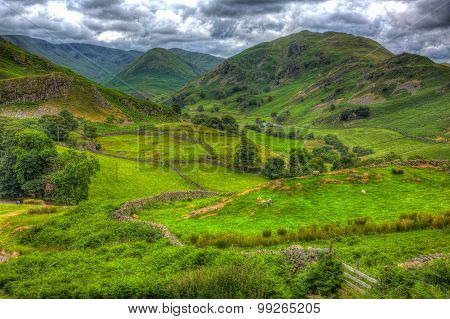 English countryside scene the Lake District Martindale Valley near Ullswater with mountains and wall