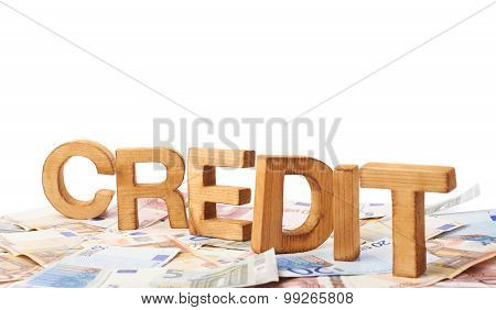 Word Credit over the pile of money