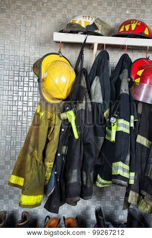 Firefighter suits and equipment arranged at fire station