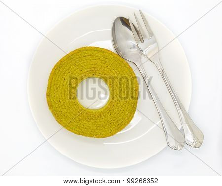 Rounded green tea layers cake on white dish