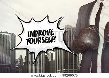 Improve yourself text with businessman wearing boxing gloves
