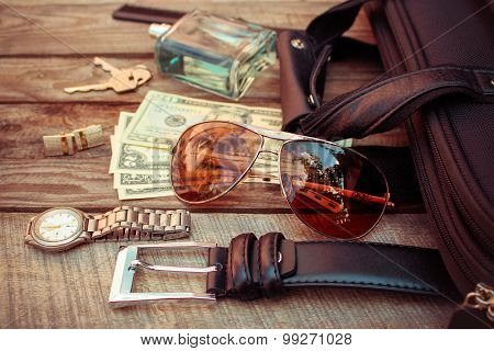 Men accessories: sunglasses, bag, money, wrist watch, cufflinks, comb, strap, keys, perfume