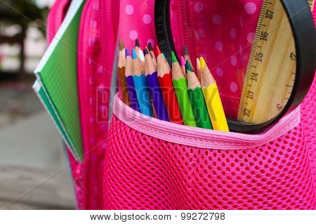 Stationery objects. School supplies are in school backpack.