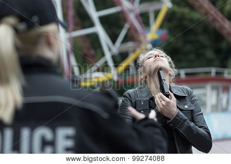 Girl Holding Gun Under Chin