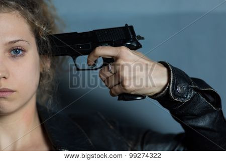 Woman Holding Gun To Temple