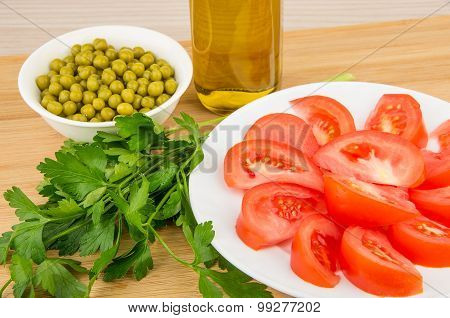 Tomatoes, Green Peas, Parsley And Olive Oil On Board