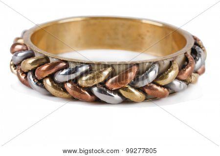 Braiding ancient bronze bracelet on white