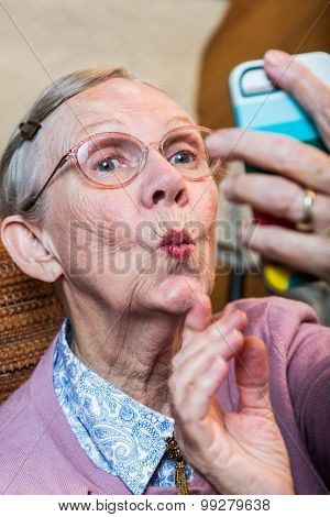 Happy Elder Woman Taking Selfie
