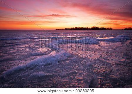 Beautiful Winter landscape with sunset fiery sky.