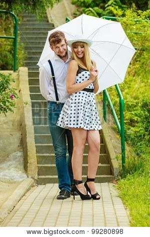 Loving Couple Retro Style Flirting On Stairs