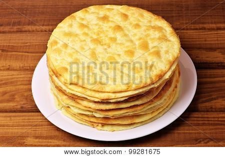 Shortcakes for a delicious cake Napoleon on the plate.