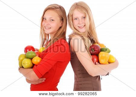 Two Girl Holding Fresh Fruits
