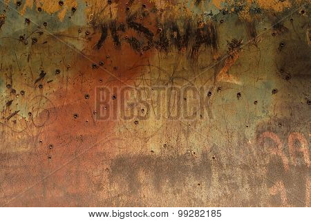 Bullet Holes In Rusty Metal Plate