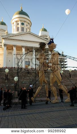 Eight meters tall wooden giants at the Night of Arts festival in Helsinki, Finland
