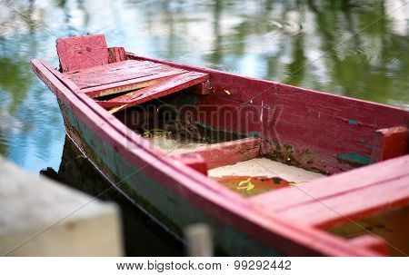 The old wooden boat on the river