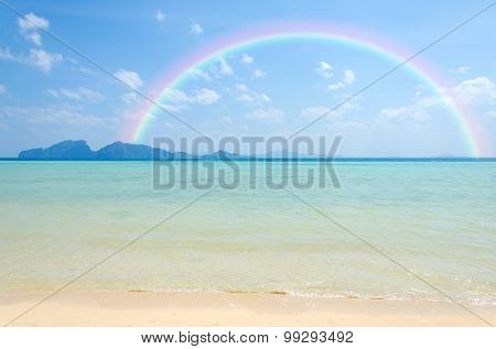 Colorful Rainbow Over A Tropical Beach Of Andaman Sea Thailand.