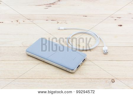 Grey Powerbank And Usb Cable For Smartphone.