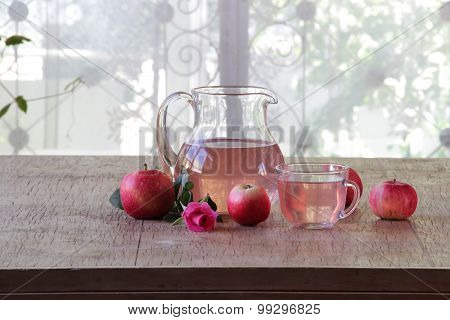 Still-life With Fresh Apples, Compote In A Transparent Jug And A Rose