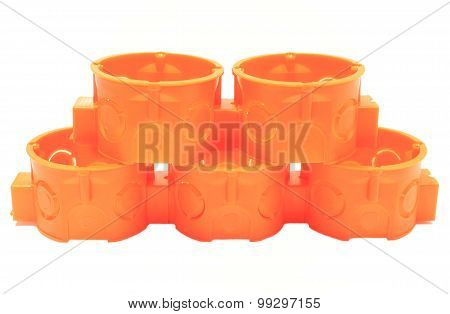 Stack Of Orange Electrical Boxes On White Background