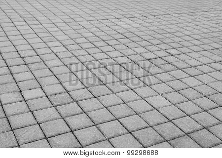 Grey brick stone street road. Light sidewalk, pavement texture