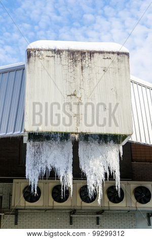Large Icicles Hanging From Industrial Drains