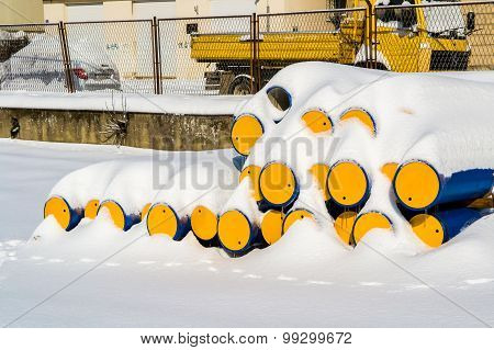 Industrial Piping Covered With Snow