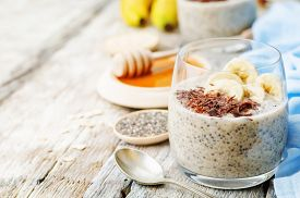 foto of oats  - overnight banana oats quinoa Chia seed pudding decorated with banana and chocolate - JPG