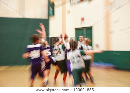 Youth basketball motion blurred image, lens effect.