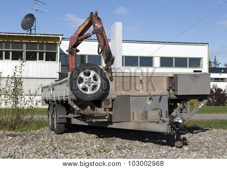 Trailer with a crane