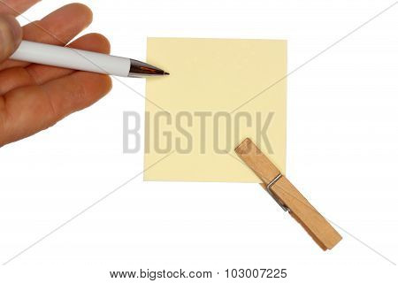 Hand With pen And Yellow Paper