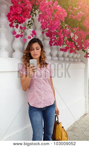 Beautiful Woman Browsing Internet On Smart Phone