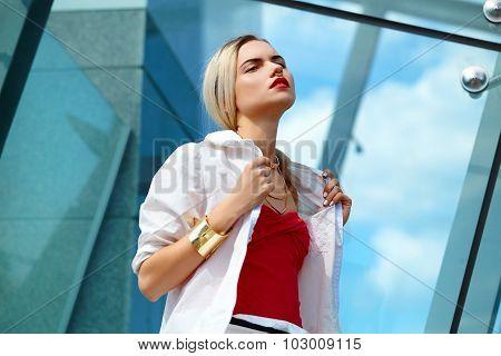 Portrait of young girl in white windbreaker.