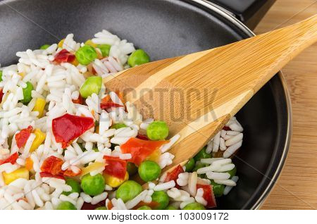 Frying Pan With Vegetable Mix And Spoon