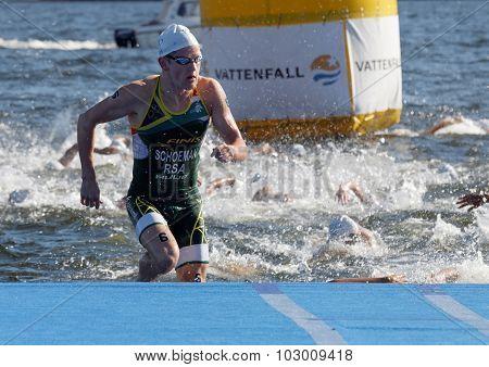 Swimmer Henri Schoeman (rsa) Climbing Up From The Water