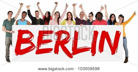 Berlin Group Of Young Multi Ethnic People Holding Banner