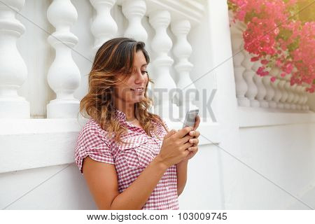 Cheerful Lady Smiling While Using Smart Phone