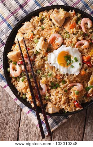 Nasi Goreng With Chicken, Shrimp And Vegetables Closeup Vertical Top View