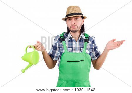 Young cheerful gardener with watering can isolated on white