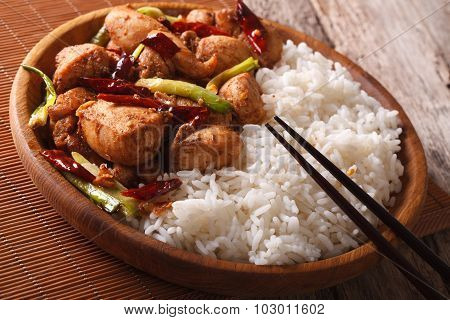 Chinese Food: Rice With Chicken Kung Pao On A Plate Close-up. Horizontal