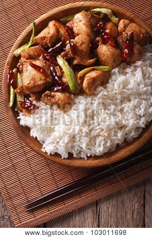 Rice With Spicy Kung Pao Chicken Close-up. Vertical Top View