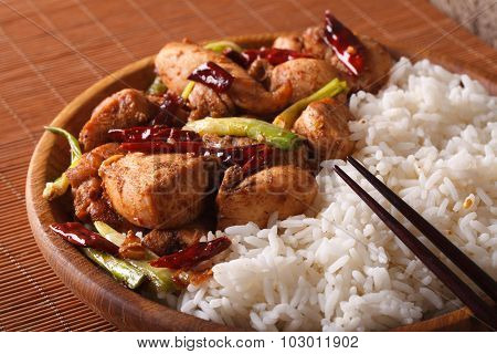 Chinese Cuisine: Kung Pao Chicken And Rice Close-up. Horizontal