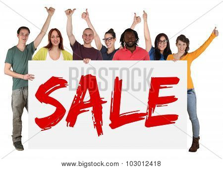 Group Of Young Multi Ethnic People Holding Banner Sale While Shopping