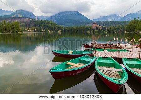 Colorful Wooden Boat On  Mountain Lake .