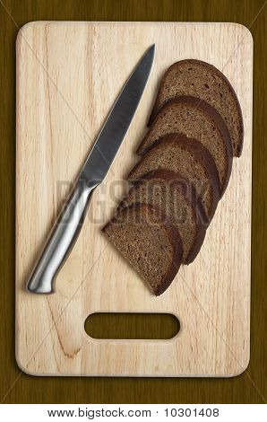 Metallic Knife And Sliced Bread