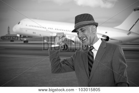 Happy business man at the airport