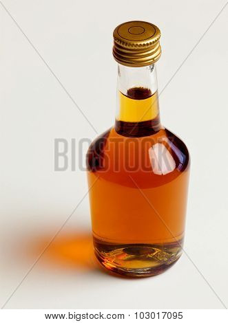 Bottle of cognac with reflection