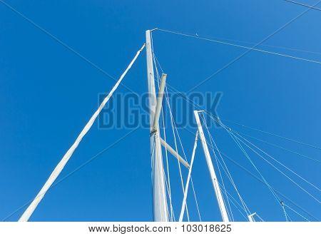 Close Up Of Yacht Mast On Sky Background